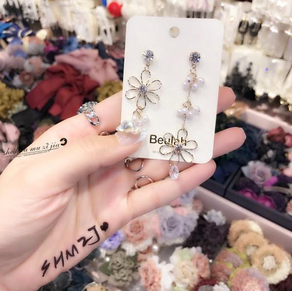 ต่างหูเกาหลีก้านเงิน S925 อะไหล่ทองแต่งพุ่มไข่มุกห้อยยาวสลับสั้นปลายรูปดอกไม้ห้อยเพชรสวิส CZ Diamond เกรด AAA