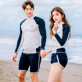 ชุดว่ายน้ำคู่รักแขนยาวกางเกงขาสั้นสีขาวดำผ้ากันแดดรังสี UV