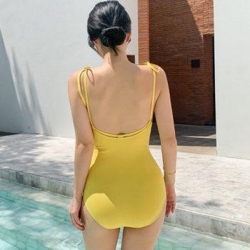 ชุดว่ายน้ำวันพีชสีเหลืองเข้มแบบสวมแต่งสายสอดด้านหลังสายตรงไหล่ผูกโบว์